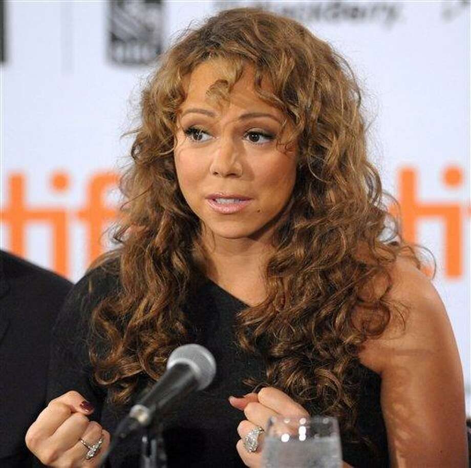 "In this Sept. 13, 2009 photo, singer-actress Mariah Carey participates in news conference for the film ""Precious"" during the Toronto International Film Festival in Toronto. Veterinarian Cindy Bressler sued Carey on Wednesday, June 23, 2010, in New York, claiming that Grammy Award-winning singer owes her more than $30 thousand in veterinary medical fees.  (AP Photo/Evan Agostini) Photo: AP / AGOEV"