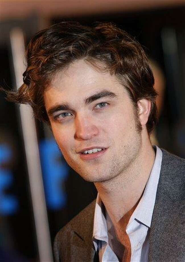 "FILE - In this March 17, 2010 file photo, British actor Robert Pattinson arrives on the red carpet for the UK premiere of ""Remember Me"" at the Leicester Square Odeon cinema in central London. (AP Photo/Joel Ryan,file) Photo: AP / AP2010"