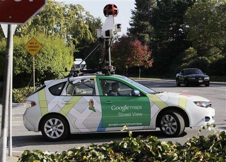"""A Google driver drives with a Google vehicle around Palo Alto, Calif., streets Wednesday, Oct. 27, 2010 to shoot """"Street Views"""". The Federal Trade Commission is scolding Google, but not taking any further action against the company for collecting personal information transmitted over unsecured wireless networks.(AP Photo/Paul Sakuma) Photo: AP / AP"""