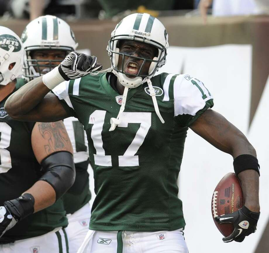 New York Jets' Plaxico Burress celebrates this third touchdown during the fourth quarter of an NFL football game against the San Diego Chargers, Sunday, Oct. 23, 2011, in East Rutherford, N.J. The Jets defeated the Chargers 27-21. (AP Photo/Bill Kostroun) Photo: AP / FR51951 AP