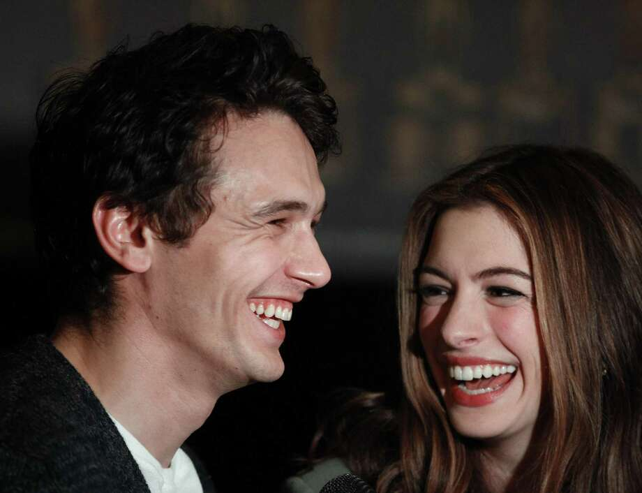 Actors James Franco, left, and Anne Hathaway talk to the media at the Kodak Theatre in the Hollywood section of Los Angeles, Thursday. Franco and Hathaway are hosting the 83rd Academy Awards, which airs Sunday. (AP Photo/Chris Carlson) Photo: ASSOCIATED PRESS / AP2011