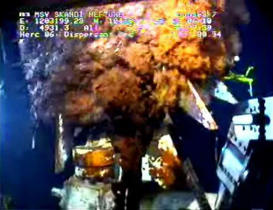 This image from video provided by BP PLC early Wednesday, June 23, 2010 shows oil continuing to gush from the broken wellhead, at the site of the Deepwater Horizon oil well in the Gulf of Mexico. The logistics coordinator onboard the ship that's been siphoning oil from a gushing well in the Gulf of Mexico tells The Associated Press that a cap on top has been reattached and is again capturing some of the crude.  (AP Photo/BP PLC) Photo: AP / BP PLC