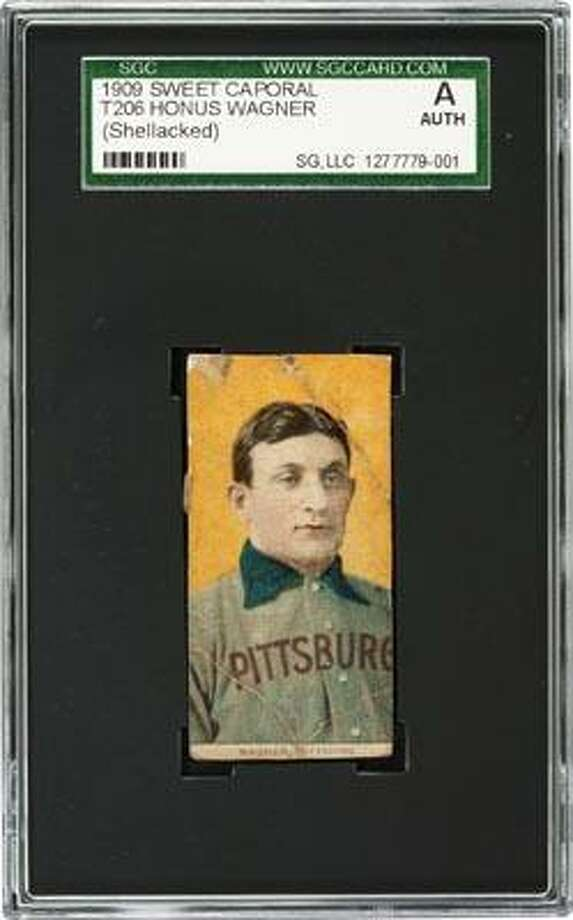 This undated photo provided by Heritage Auctions shows a rare century-old T206 Honus Wagner baseball card. A Baltimore convent is getting some help for its charitable mission from an unexpected source: this rare, century-old baseball card. The School Sisters of Notre Dame inherited the T206 Honus Wagner baseball card from a late nun's brother after he died earlier this year. About 50 of the Wagner cards are believed to exist, the most famous of which sold for $2.8 million. The nuns' card is in poor condition but is still expected to fetch up to $200,000 at auction next month. (AP Photo/Courtesy of Heritage Auctions) Photo: AP / Heritage Auctions
