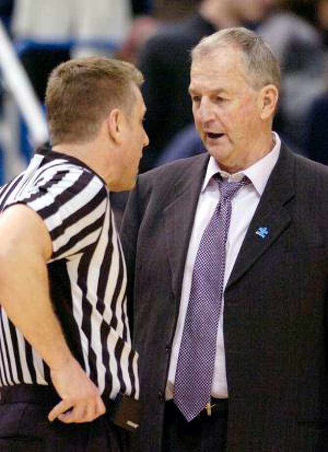 "AP Connecticut coach Jim Calhoun speaks with an official during the first half of his team's 78-70 victory over Georgetown on Feb. 16 in Hartford. Calhoun released a statement Friday responding to the NCAA's findings and said ""the buck stops here."""