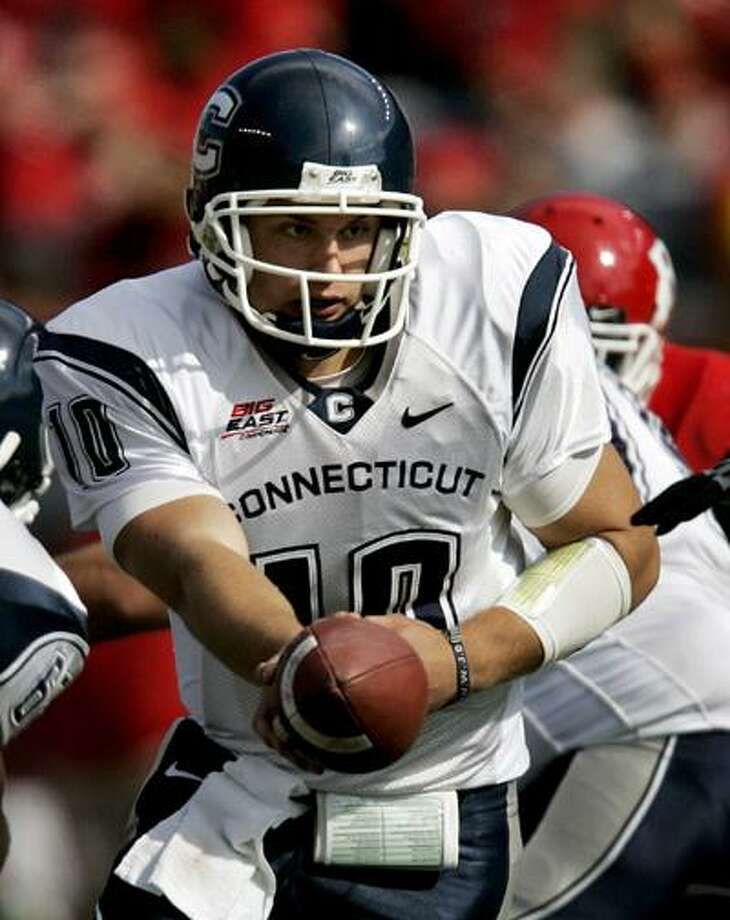 Connecticut quarterback Zach Frazer holds the ball during the second quarter of an NCAA college football game against Rutgers on Saturday, Oct. 18, 2008, in Piscataway, N.J. Rutgers won 12-10.(AP) Photo: ASSOCIATED PRESS / AP2008