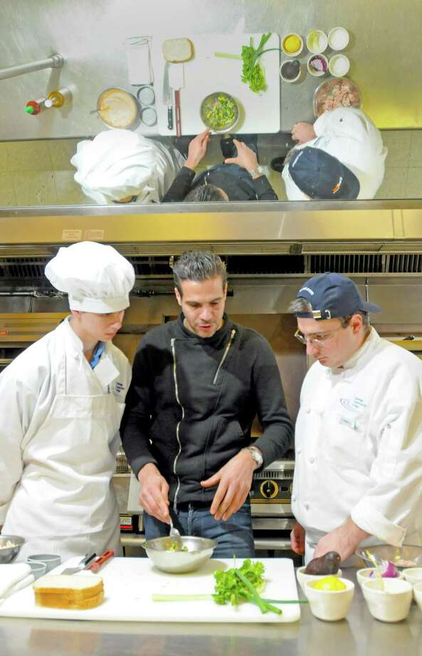 """Angelo Sosa, a """"Top Chef"""" contestant from season 7, center, with students Nicholas Shafransky of West Haven, left, and Joshua Semeraro of Waterbury at Gateway Community College in New Haven.(Peter Hvizdak/Journal Register News Service)"""