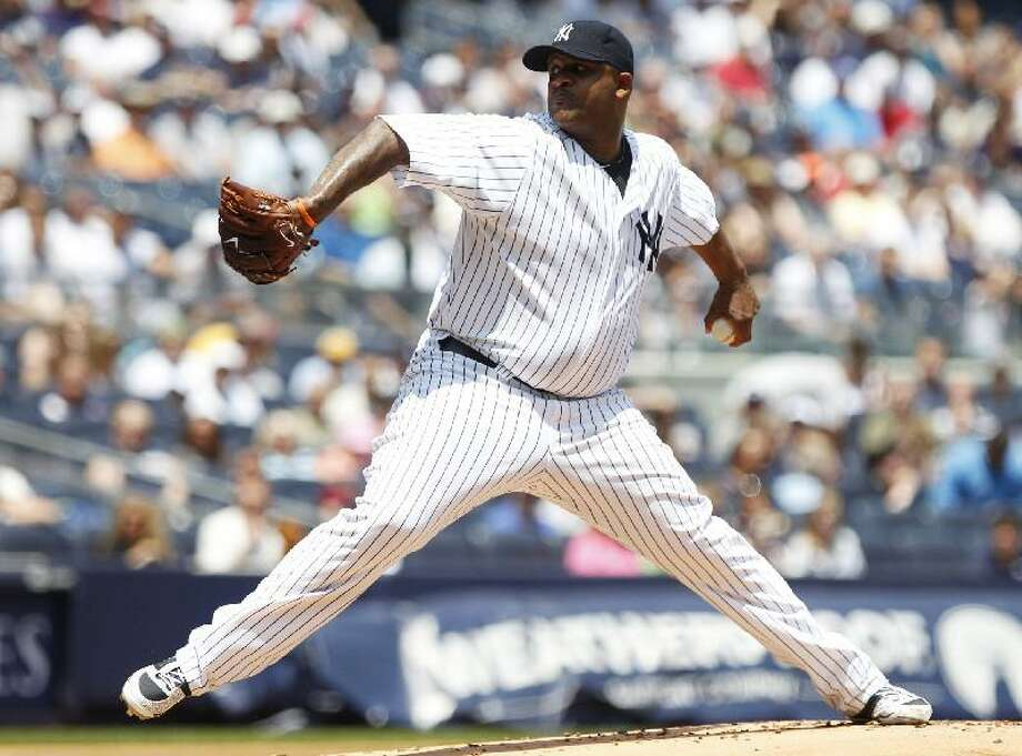 ASSOCIATED PRESS New York's CC Sabathia delivers a pitch during the first inning of a game against the Colorado Rockies Saturday at Yankee Stadium in New York. The Yankees won 8-3.