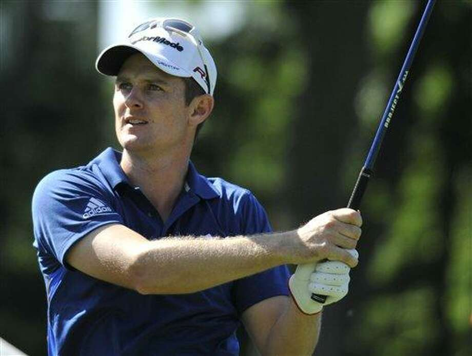 Justin Rose of England tees off on the 18th hole during the second round of the Travelers Championship golf tournament on Friday in Cromwell. Photo: AP / AP2010