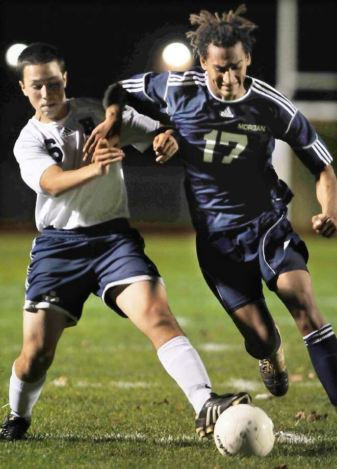 H-K's Joey LaRosa and Morgan's Sam Schultz battle for possession of the ball in the second half of a match in Higganum. (Catherine Avalone / TheMiddletownPress