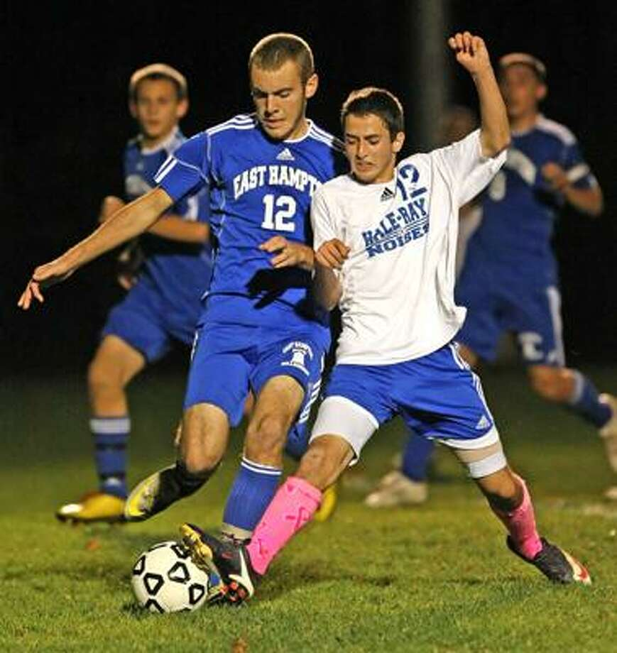 Hale Ray's Ian Navin and East Hampton's Stephan Marsiglio jockey battle for position and the ball Thursday in Moodus. (Todd Kalif