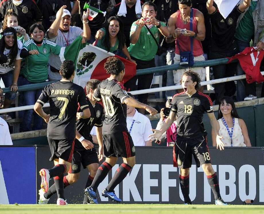 ASSOCIATED PRESS Mexico's Andres Guardado, right, celebrates his goal with teammates during the first half of the CONCACAF Gold Cup final match against the United States Saturday in Pasadena, Calif. Mexico won 4-2.