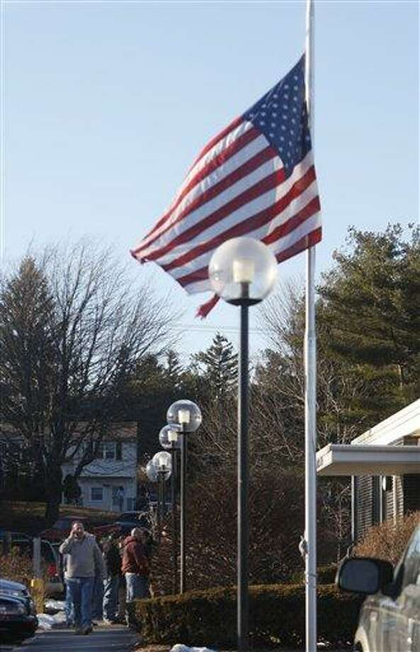 A flag flies at half-mast at a Plumbers and Pipefitters Local 777 training center where members gather for a meeting about the explosion at the Kleen Energy Systems power plant yesterday in Meriden Monday. ( AP Photo/Seth Wenig) Photo: AP / AP