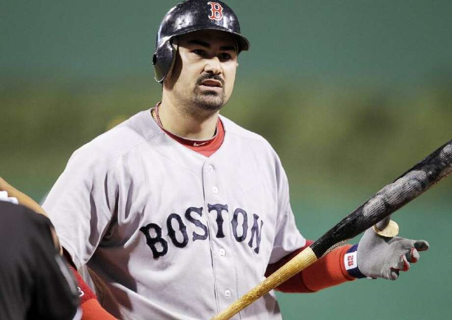 ASSOCIATED PRESS Boston's Adrian Gonzalez walks back to the dugout after striking out against Pittsburgh Pirates closer Joel Hanrahan to end an interleague game in Pittsburgh Saturday. The Red Sox lost 6-4.