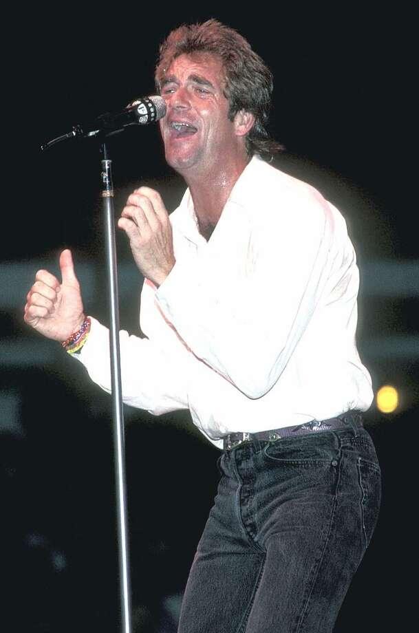 Singer Huey Lewis is shown performing on stage during a Huey Lewis & the News concert appearance. Photo: John Atashian / John Atashian