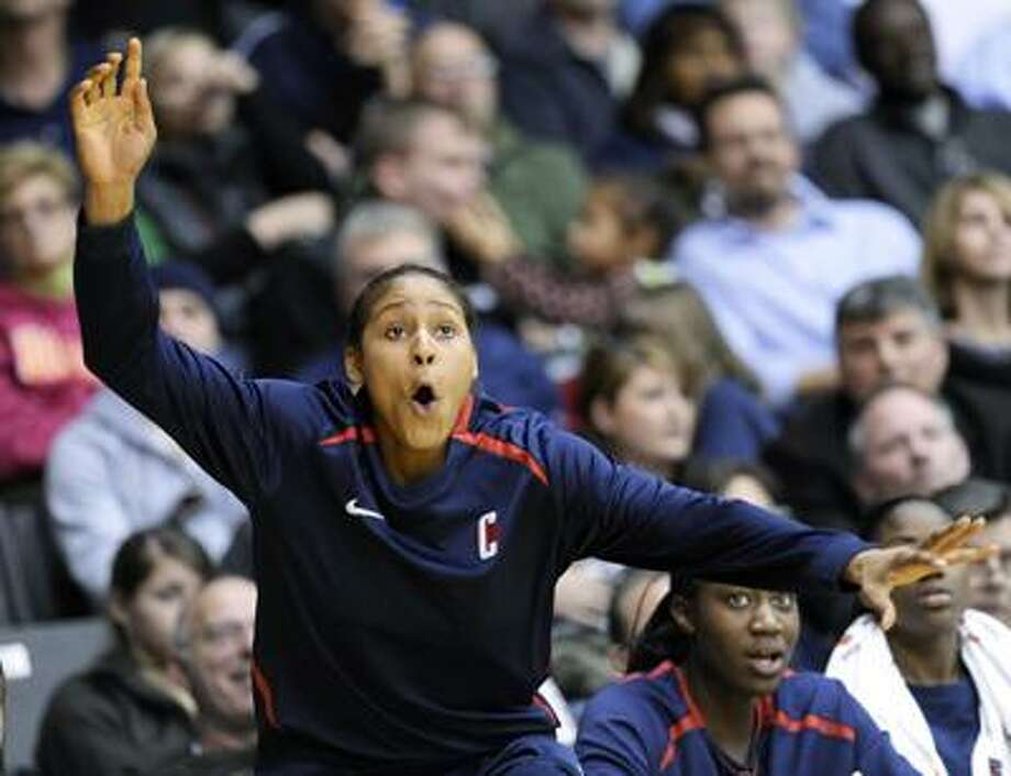 Connecticut forward Maya Moore reacts to a play from the bench during the second half of a Jan. 23 game at Villanova. (Associated Press) Photo: ASSOCIATED PRESS / AP2010