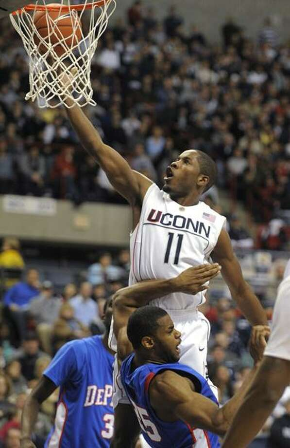 Connecticut's Jerome Dyson scores two of his team-high 20 points while being guarded by DePaul's Eric Wallace during the second half of Connecticut's 64-57 win last Saturday. (Associated Press) Photo: ASSOCIATED PRESS / AP2010
