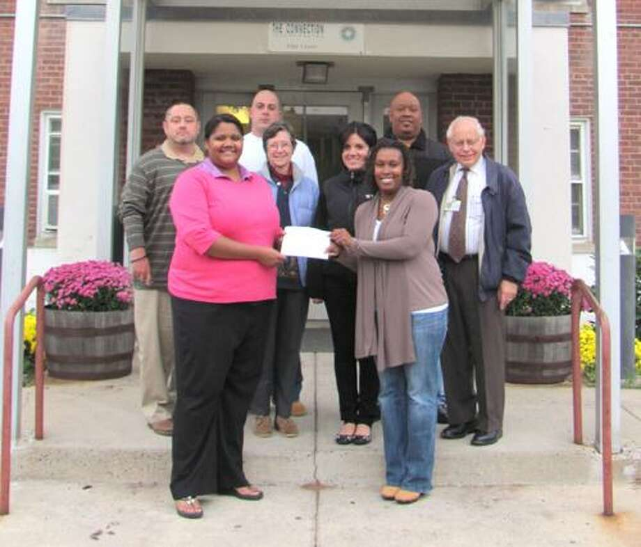 In the picture are (Front) Shelter Program Director Mackenzie Tyson receiving the donation from Tanya Burke of Project Hope. (Back L to R) Patrick Fallon of Project Hope, Michael Zavarella of Project Hope, Carolyn Shaw of the Human Relations Committee of Middletown, Diane Lanteri of Project Hope, Henry Fernandez of Project Hope and Arthur Myers of the Human Relations Committee of Middletown.