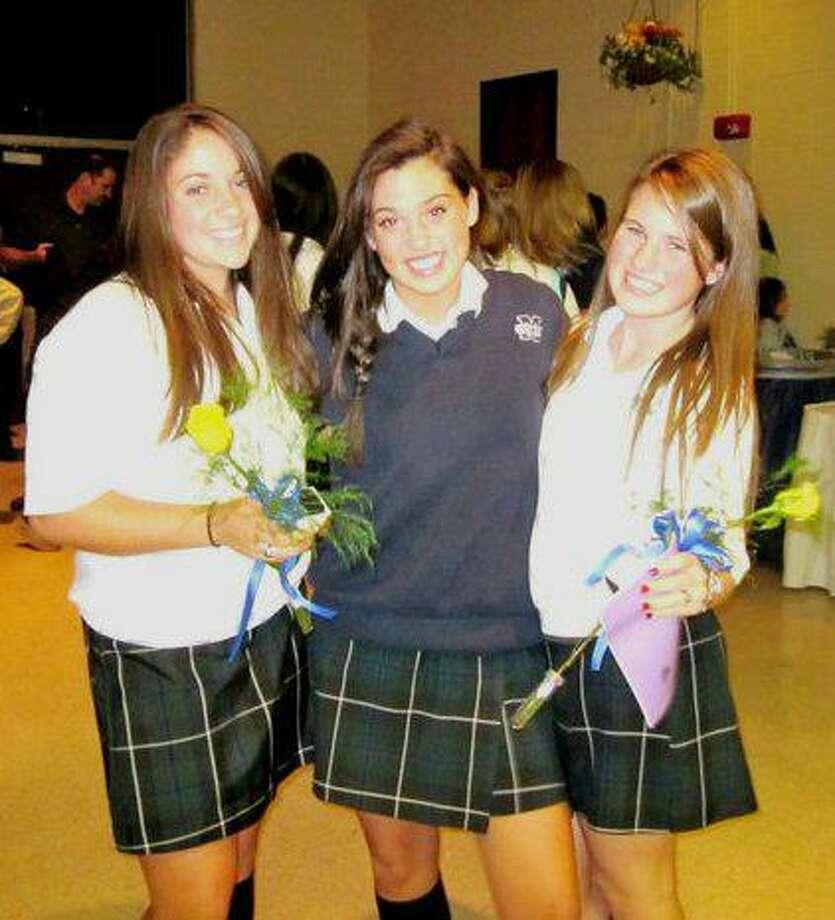 Mercy Juniors Kelly Murphy, Elizabeth Konefal and Meghan Garrity celebrate receiving their class rings.