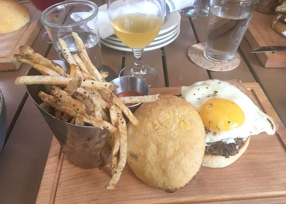 The farmhouse burger with candied bacon and fried egg from the Retreat Gastropub. Photo: Bill Roseberry