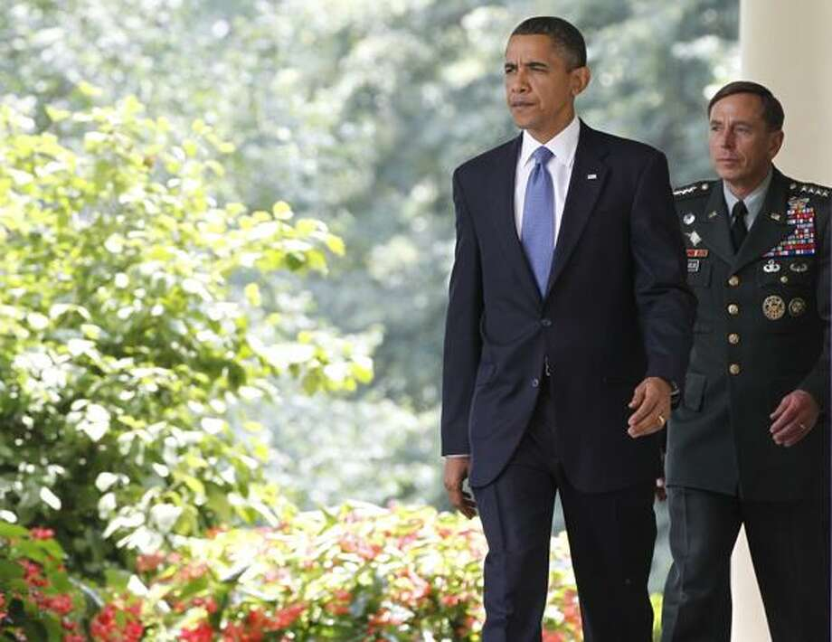President Barack Obama, followed by Gen. David Petraeus, walks to the Rose Garden of the White House in Washington, Wednesday, after meeting with Commander of U.S. and NATO forces in Afghanistan Gen. Stanley McChrystal. (AP) Photo: ASSOCIATED PRESS / AP