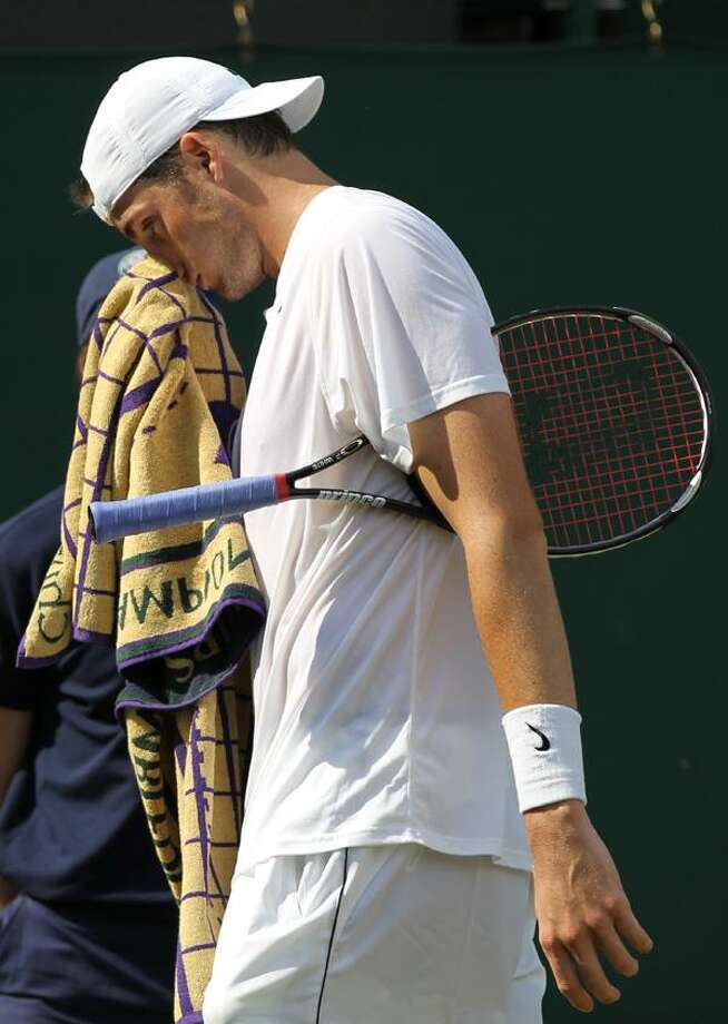 John Isner of the U.S. cools down during his men's singles match against Nicolas Mahut of France, at the All England Lawn Tennis Championships at Wimbledon, Wednesday. (AP) Photo: ASSOCIATED PRESS / AP