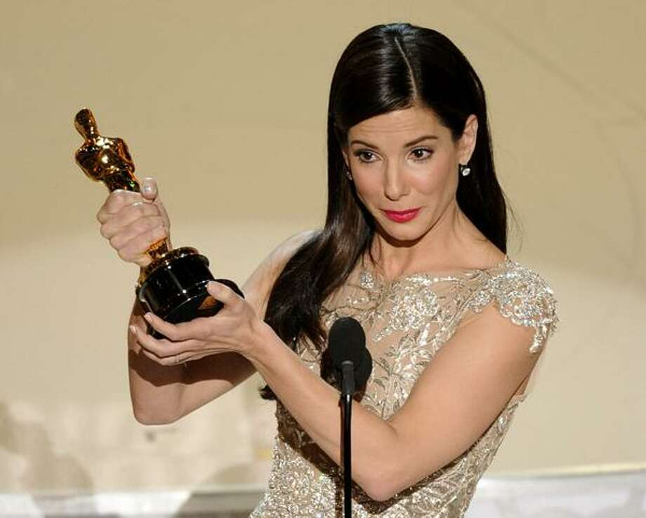 """In this March 7, 2010 file photo, Sandra Bullock accepts the Oscar for best performance by an actress in a leading role for """"The Blind Side"""" at the 82nd Academy Awards in the Hollywood section of Los Angeles. (AP) Photo: AP / AP2010"""