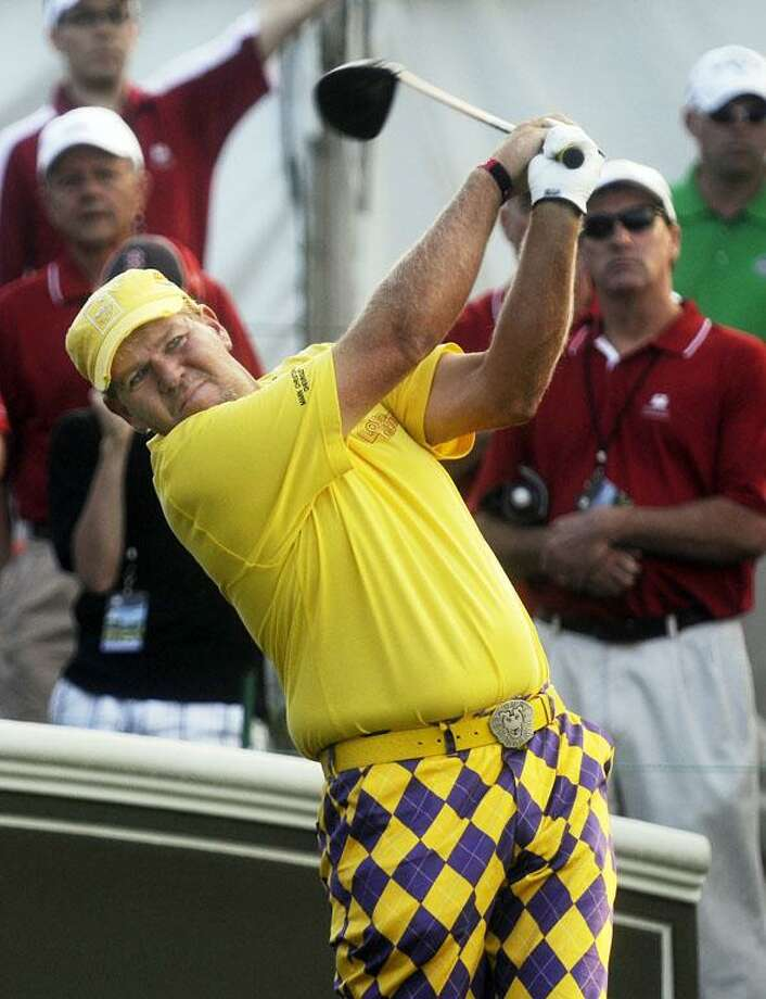 John Daly tees off on the first hole during the Pro-Am at the Travelers Championship golf tournament Wednesday in Cromwell. (AP) Photo: AP / The Hartford Courant
