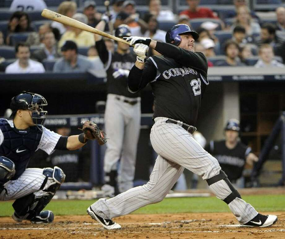 ASSOCIATED PRESS Colorado Rockies designated hitter Jason Giambi follows through on a home run during the second inning of an interleague game against the New York Yankees Friday at Yankee Stadium in New York. The Yankees lost 4-2.