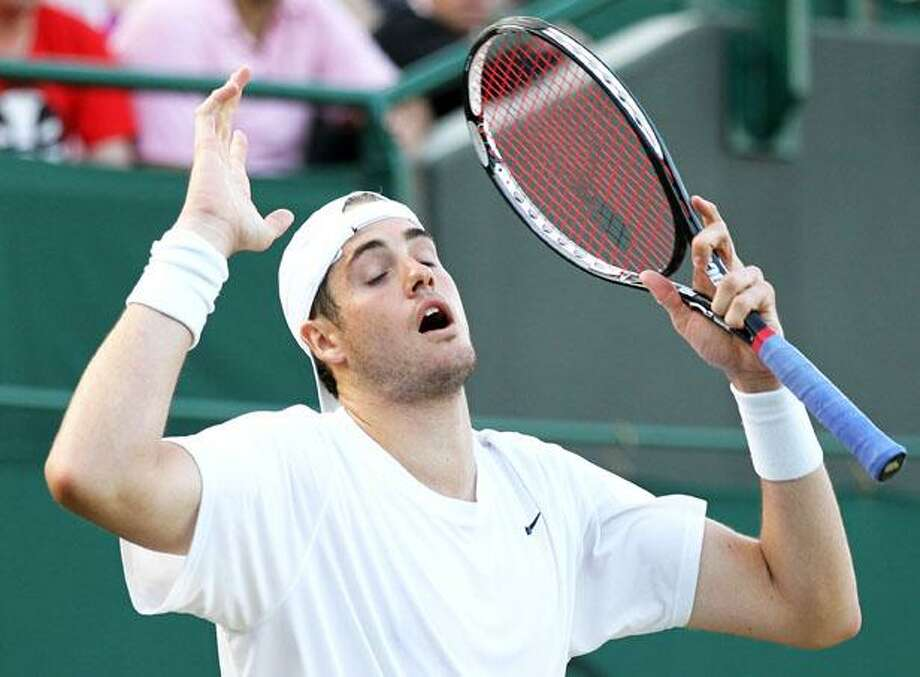 John Isner of the U.S., gestures during his epic men's singles match against Nicolas Mahut of France, at the All England Lawn Tennis Championships at Wimbledon today. (AP) Photo: AP / AP