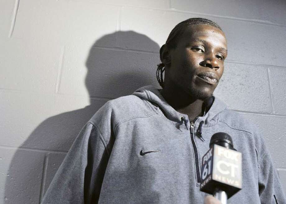 ASSOCIATED PRESS FILE PHOTO In this May 7, 2010 file photo, Connecticut's Ater Majok speaks to the media after a news conference for men's basketball coach Jim Calhoun in Storrs. Majok withdrew from the school after playing in just 26 games for the Huskies. Majok was taken late Thursday night with the 58th pick in the NBA Draft by the Los Angeles Lakers.