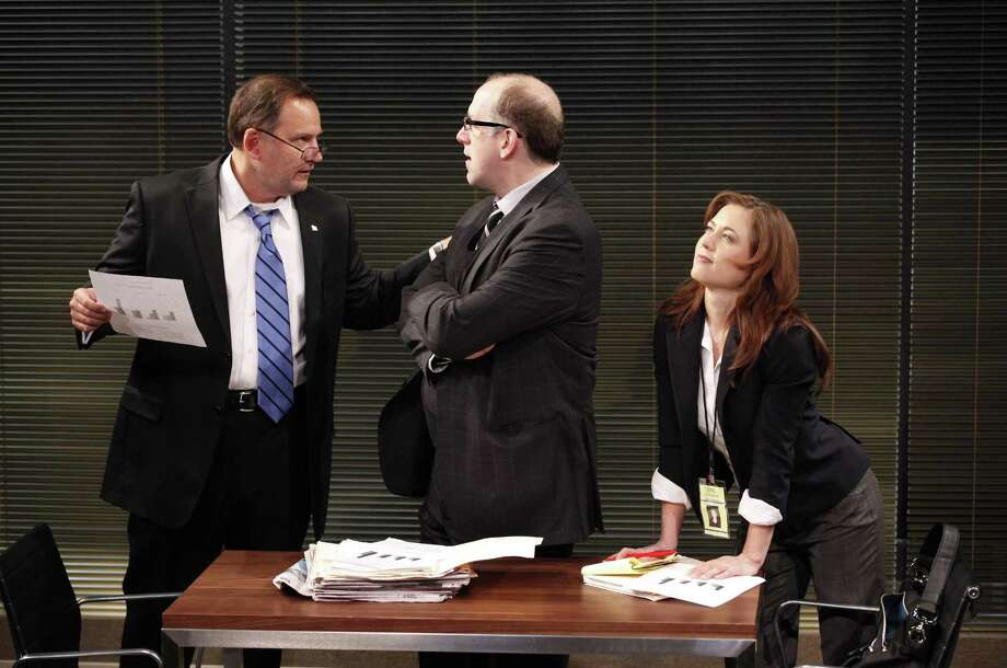 "In this theater publicity image released by Karen Greco Public Relations, Brian Dykstra, left, Michael Puzzo and Eve Danzeisen, right, are shown in a scene from, ""The Body Politic,"" in New York. (AP Photo/Karen Greco Public Relations, Carol Rosegg) Photo: AP / Karen Greco Public Relations"