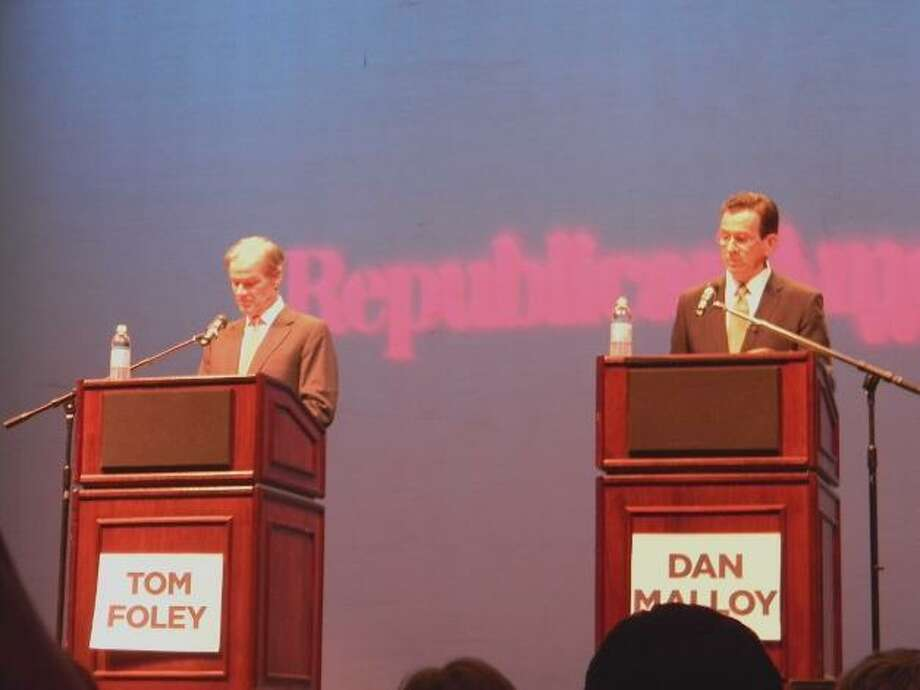 MIKE AGOGLIATI/Register Citizen Gubernatorial hopeful Republican Tom Foley, left, and Democrat Dan Malloy prepare for their debate at the Warner Theatre on Torrington on Monday night.