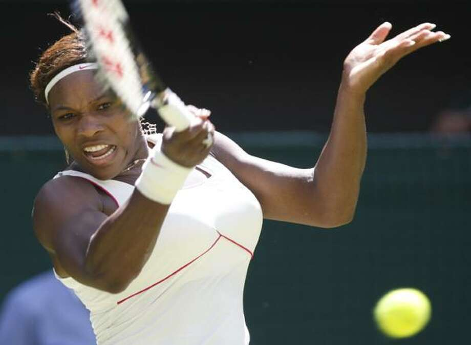 Defending champion Serena Williams returns to Michelle Larcher De Brito of Portugal, during their women's singles, first round match on the Centre Court at the All England Lawn Tennis Championships at Wimbledon, Tuesday. (AP) Photo: ASSOCIATED PRESS / AP