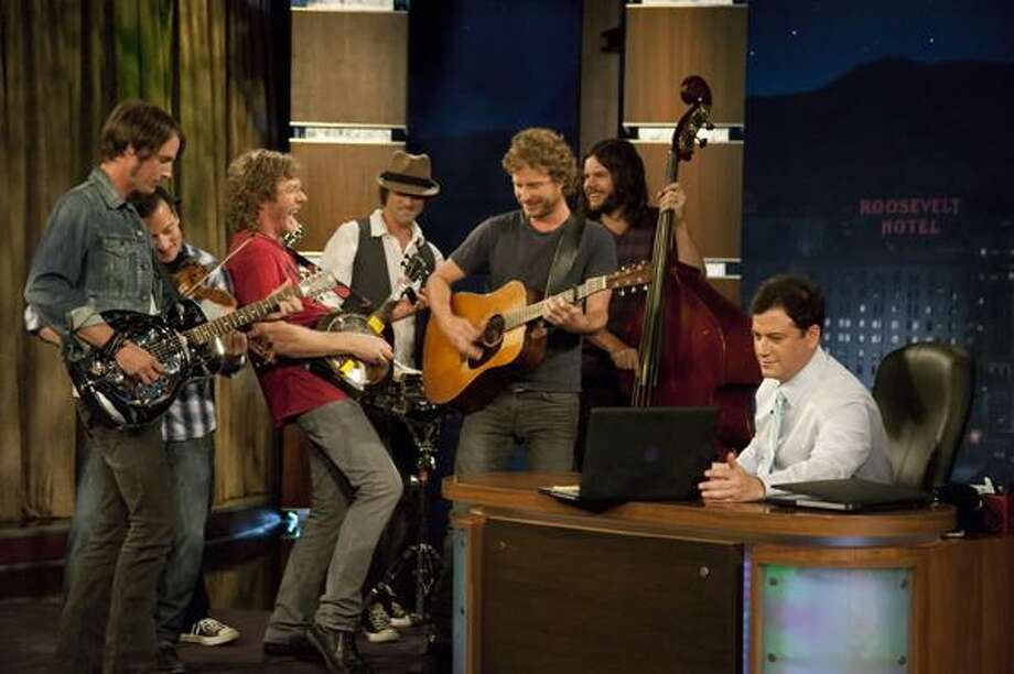"In a photo provided by ""Jimmy Kimmel Live,""  Dierks Bentley, center with guitar, and his band are recorded on a laptop computer on the desk in front of Jimmy Kimmel, right, at the taping of the ""Jimmy Kimmel Live"" show in Los Angeles.  The show was recorded on a laptop after a power outage shut down the  control room, broadcast transmission center, and tape operations area.  The show will be broadcast on ABC Wednesday at 12:05 a.m. EDT.  (AP) Photo: ASSOCIATED PRESS / Jimmy Kimmel Live"