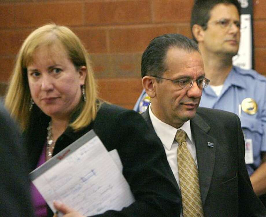 Hartford Mayor Eddie Perez, center, is shown in Hartford Superior Court Friday on the second day of jury deliberations in his corruption trial in Hartford, Conn. At left is his attorney Hope Seeley. A Connecticut jury has convicted Perez of corruption charges, including accepting home improvements as a bribe and trying to extort money from a real estate developer. (AP) Photo: ASSOCIATED PRESS / The Hartford Courant, Pool