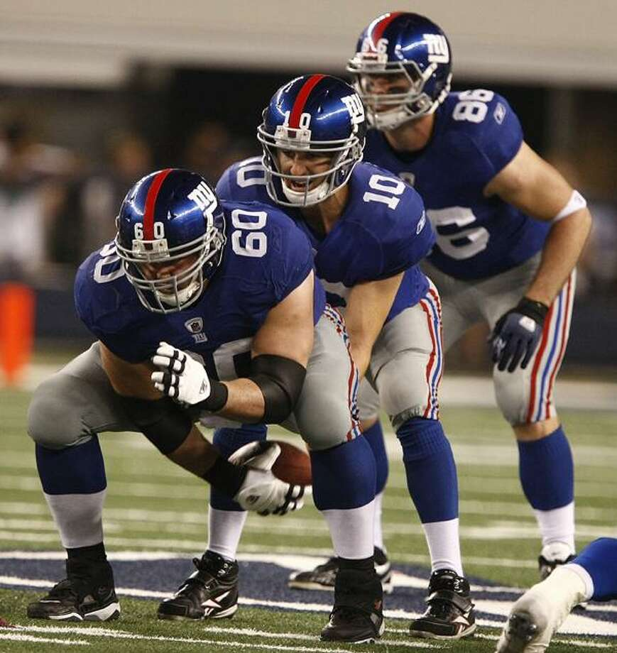 New York Giants center Shaun O'Hara (60) snaps the football to Eli Manning (10) with Bear Pascoe(86) in the background during the second half of an NFL game Monday in Arlington, Texas. (AP/Waco Tribune-Herald/Jose Yau) Photo: AP / Waco Tribune Herald 2010
