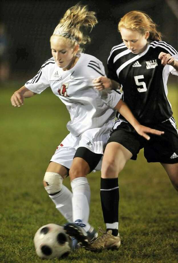 Cromwell senior Amanda LaBarge is challenged by Valley Regional senior Megan Mallon during a high school girls soccer game Tuesday at Cromwell High School. The game ended in a 1-1 tie. It was the Panthers' senior night. Cromwell's record is now 5-6-4. (Catherine Avalone / TheMiddletownPress