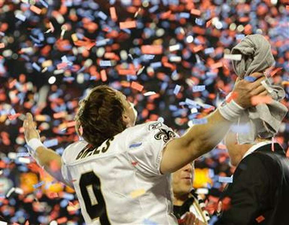 New Orleans Saints quarterback Drew Brees celebrates after the NFL Super Bowl XLIV football game against the Indianapolis Colts in Miami, Sunday, Feb. 7, 2010. The Saints won 31-17. (AP Photo/Paul Sancya) Photo: AP / AP