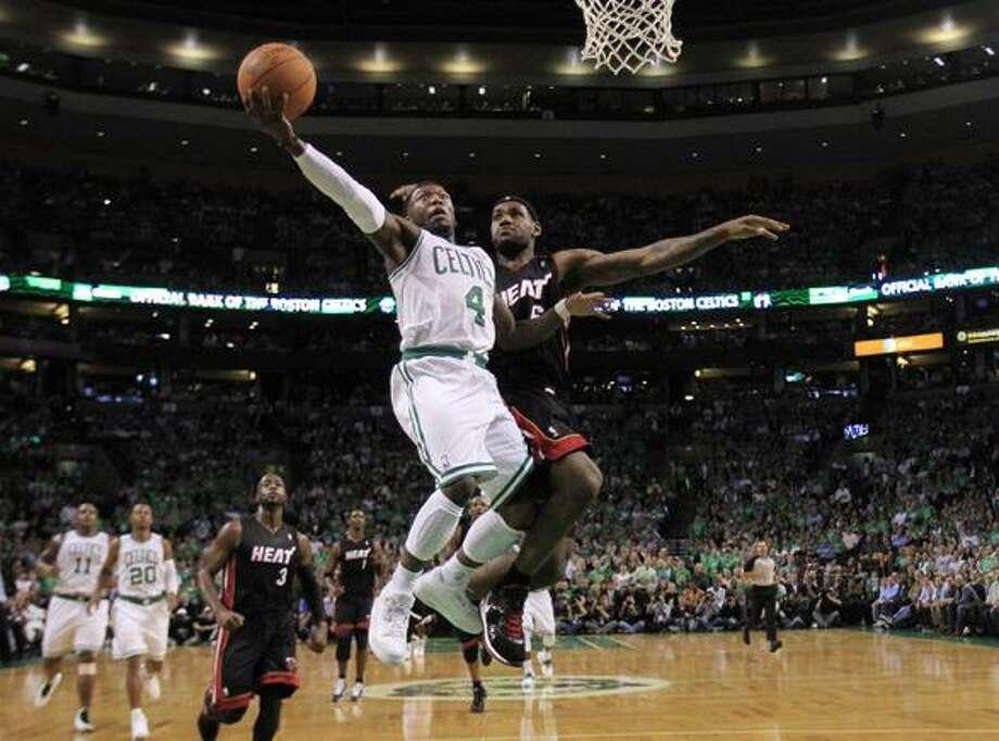 Boston Celtics guard Nate Robinson, left, drives to the basket past Miami Heat forward LeBron James, right, during the first half of an NBA basketball game in Boston, Tuesday night. Boston won 88-80.(AP Photo/Charles Krupa) Photo: AP / AP