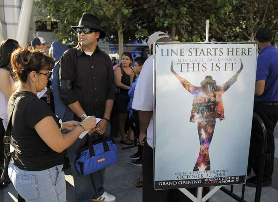 "In this Sept. 24, 2009, file photo, Michael Jackson fans arrive to buy tickets for the ""Michael Jackson's This Is It"" film, at L.A. Live in Los Angeles. (AP) Photo: AP / 2009 AP"