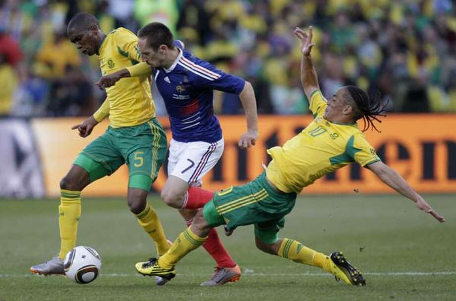France's Franck Ribery, center, dribbles past South Africa's Anele Ngcongca, left, and South Africa's Steven Pienaar during the World Cup group A soccer match between France and South Africa at Free State Stadium in Bloemfontein, South Africa, Tuesday. (AP) Photo: ASSOCIATED PRESS / AP