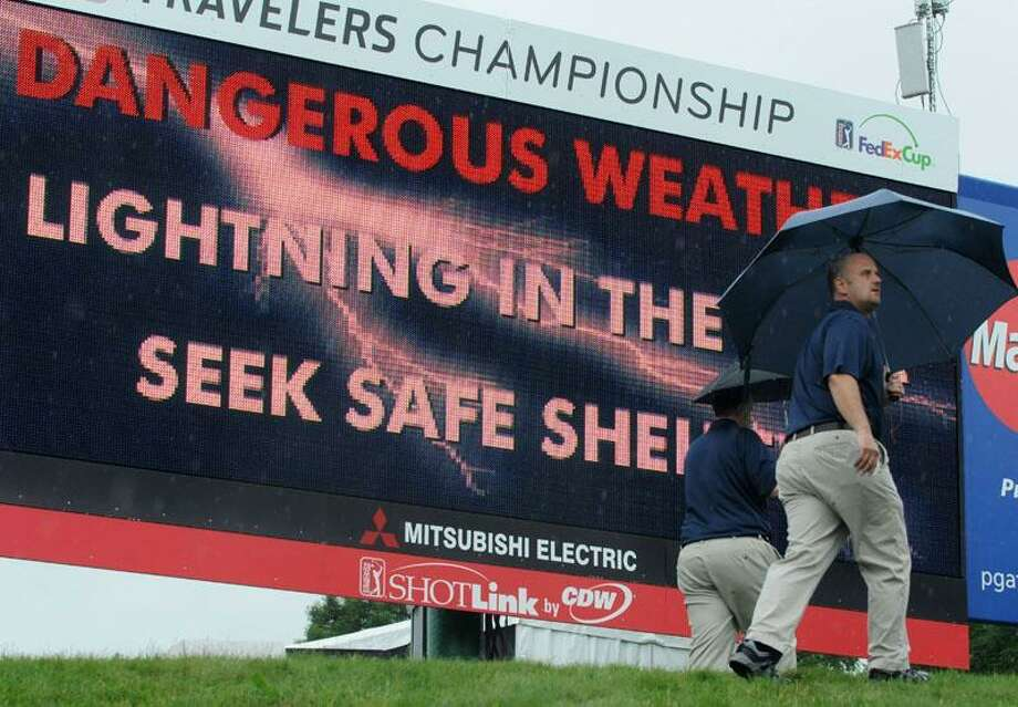 Play was stopped and people moved to shelter at around 11:30 a.m. on Thursday at the Travelers Championship in Cromwell. (Mara Lavitt/Register)