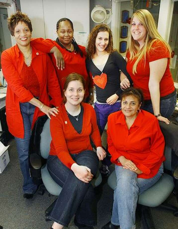 """Front from left to right, Marie Mariano and Donna Smith; back row, left to right, Gerry Howard, Jameel Thompson, Diana Kostacopoulos and Amy Spencer. Go Red for Women works to change the perception that heart disease is a """"man's disease."""" (Catherine Avalone"""