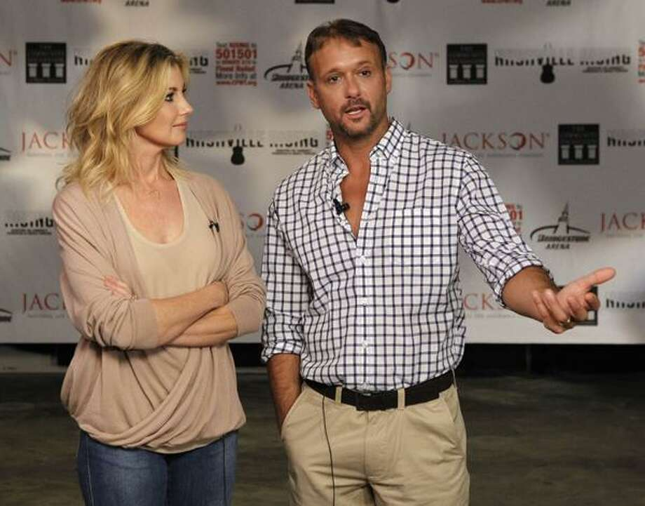 In this Monday photo, country music stars and husband and wife Faith Hill and Tim McGraw talk about spearheading the Nashville Rising concert scheduled for Tuesday in Nashville, Tenn. Big names from all music genres are coming together for the benefit concert to help victims of last month's devastating flood in Nashville. (AP) Photo: AP / AP