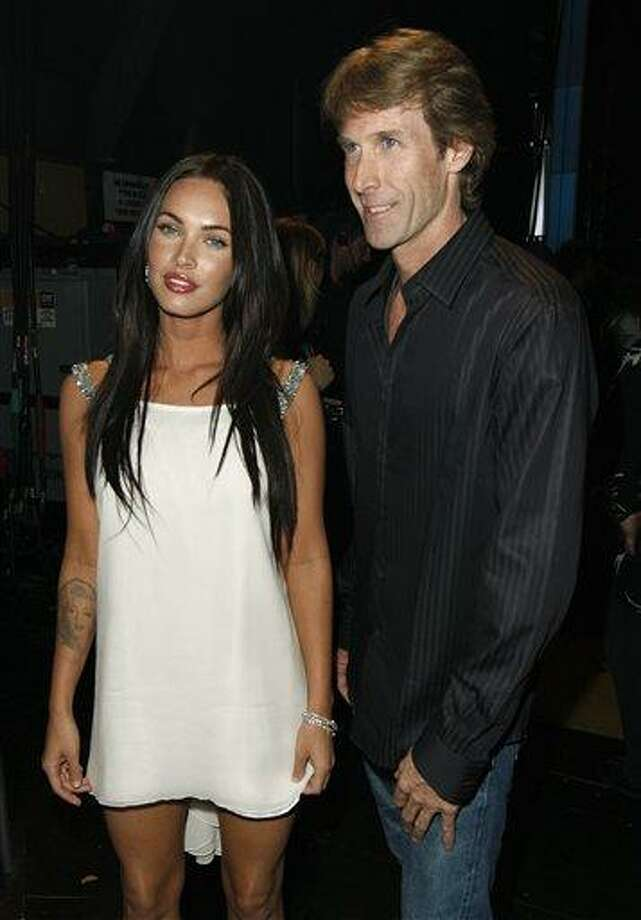 "In this June 1, 2008 file photo, actress Megan Fox, left, and director Michael Bay pose together at the MTV Movie Awards in Los Angeles. Bay directed Fox in the films ""Transformers,"" and ""Transformers: Revenge of the Fallen.""  (AP Photo/Matt Sayles, file) Photo: AP / AP2008"