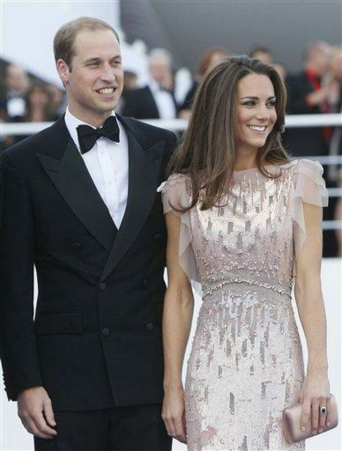 Britain's Prince William, the Duke of Cambridge,  and his wife Kate, Duchess of Cambridge arrive at a charity event for Absolute Return for Kids, ARK, in  London, in this June 9, file photo. The programme of their first overseas trip, released in London, Tuesday, sounds almost like a second honeymoon: barbecues, canoe trips, a full-day of down time free of official duties, and a chance to see the length and breadth of Canada at its full summer glory. They will see much of Canada on an eight-day voyage to celebrate Commonwealth ties, then zip in to Los Angeles, where many of the world's leading gossip columnists, fashion critics and Hollywood know-it-alls will try not to seem starstruck by the hot young royals.(AP Photo/Alastair Grant, file) Photo: AP / AP