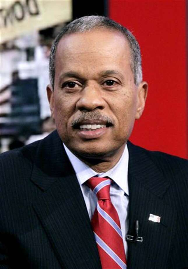 "News analyst Juan Williams appears on the ""Fox & friends"" television program in New York, Thursday, Oct. 21, 2010. Williams, who has written extensively on race and civil rights in the U.S., has been fired by National Public Radio after comments he made about Muslims on Fox News Channel's ""The O'Reilly Factor,"" on Monday. (AP Photo/Richard Drew) Photo: ASSOCIATED PRESS / AP"