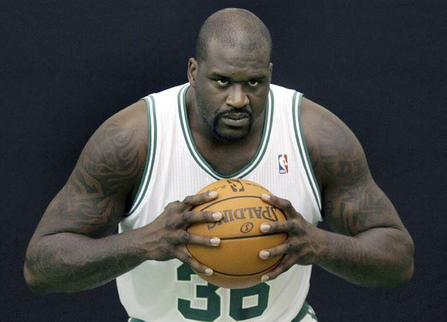 FILE - This Sept. 27, 2010, file photo shows Boston Celtics center Shaquille O'Neal posing during their media day at the team's NBA basketball training camp in Waltham, Mass. Even before his Celtics debut, O'Neal was already preparing for his next coming-out party. AP Photo/Charles Krupa, File) Photo: AP / AP