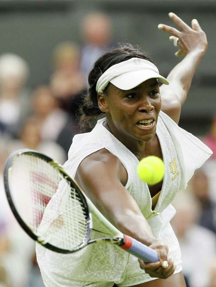 Venus Williams of the US in action during the match against Japan's Kimiko Date-Krumm at the All England Lawn Tennis Championships at Wimbledon, Wednesday, June 22, 2011. (AP Photo/Kirsty Wigglesworth) Photo: ASSOCIATED PRESS / AP2011