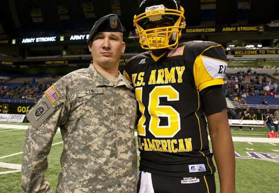 """U.S. Army Staff Sgt. David F. Cyr Jr. is one of 90 soldier heroes honored at the 2011 Army-sponsored """"All-American"""" Bowl high school football game held at the Alamodome in San Antonio, Texas."""